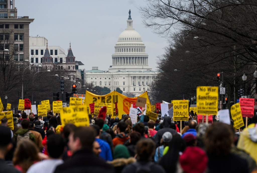 Anti-war protesters march from the White House to the Trump International Hotel in Washington, DC, on January 4, 2020.