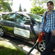 Michael Gould of Whisper Landscape Maintenance poses with his leaf blower.