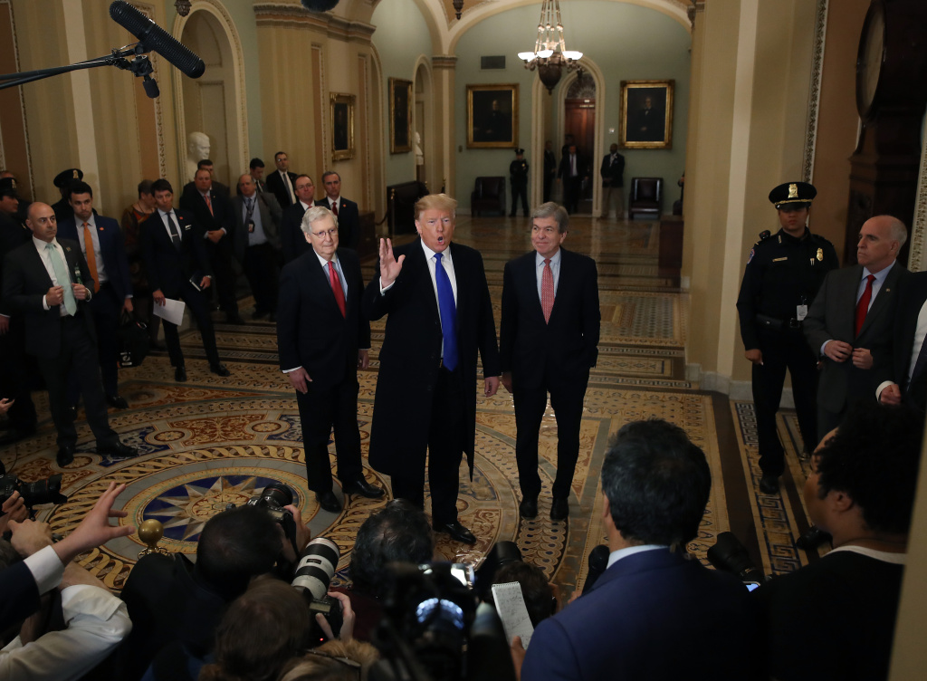 U.S. President Donald Trump (C) walks with Senate Majority Leader Mitch McConnell (L), and Sen. Roy Blunt (R-MO) after arriving at a Senate Republican weekly policy luncheon at the U.S. Capitol March 26, 2019 in Washington, DC.