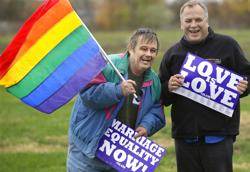 Jerry Bowman (left) and David Strzepek demonstrate at a marriage-equality rally in Springfield, Ill.