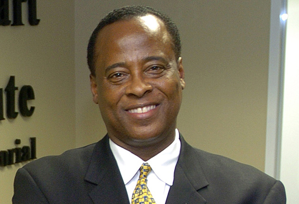 FILE - In this July 7, 2006 file photo, Dr. Conrad  Murray poses for a photo as he opens the Acres Homes Cardiovascular Center at the Tidwell Professional Building, in Houston. Murray is the target of a manslaughter investigation into the singer's death. A search warrant filed in a Houston court Thursday July 23, 2009 allowed authorities to seek evidence of whether Dr. Conrad Murray committed manslaughter. The doctor accused of administering a powerful anesthetic that killed pop star Michael Jackson has helped stabilize a young woman who fell unconscious on a US Airways jet to Phoenix.