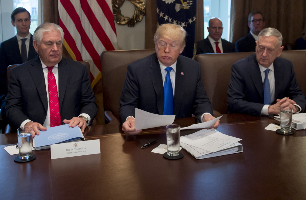 US President Donald Trump holds a Cabinet Meeting alongside Secretary of State Rex Tillerson (L) and Secretary of Defense Jim Mattis (R) in the Cabinet Room at the White House in Washington, DC, December 20, 2017.