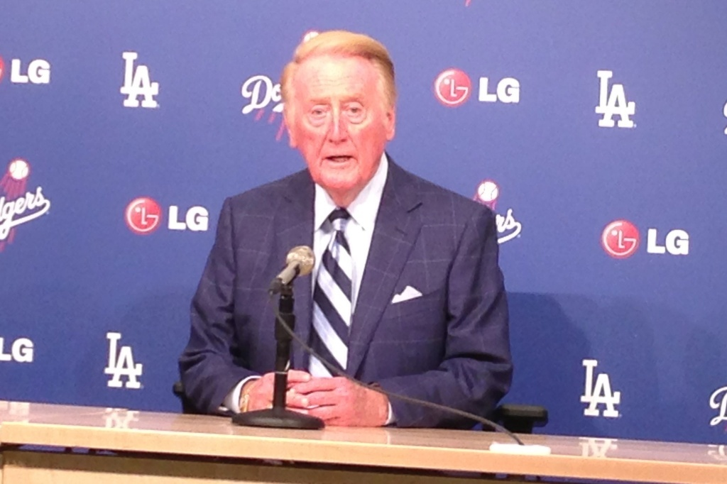 Vin Scully told reporters Friday he now starts every season thinking it could be his last, but he'll return for a 65th season next year.