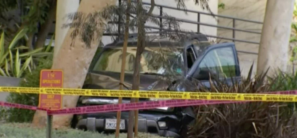 A man being escorted by police for a medical examination broke free from officers and carjacked an SUV on Wednesday. At some point the man crashed and officers shot and wounded him.