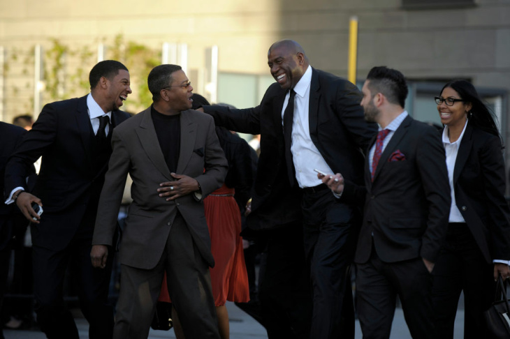 Retired Lakers point guard Magic Johnson speaks to media outside LA Live on Thursday afternoon before a private memorial for Lakers owner Dr. Jerry Buss.