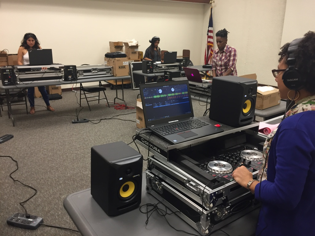 The young DJ's work on their mixes at the Compton public library.