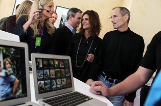 Apple CEO Steve Jobs (right) looks at a display of the new MacBook Air during an Apple special event at the company's headquarters on Oct. 20, 2010 in Cupertino, Calif.