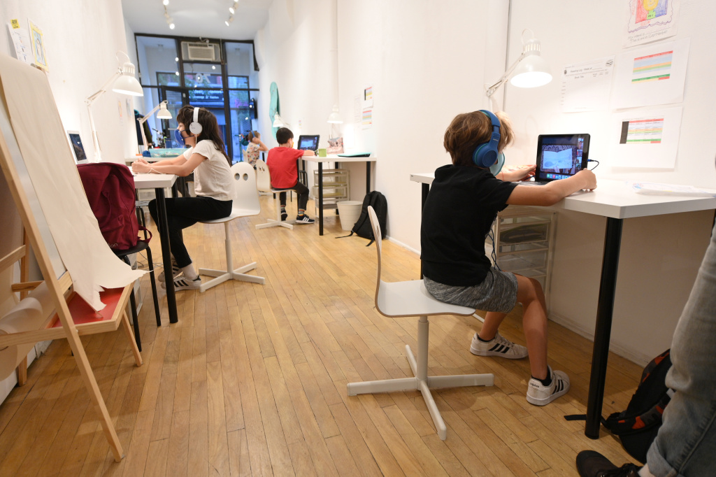 Second and third grade students attend class in person at an art gallery turned learning pod on October 01, 2020 in New York City.