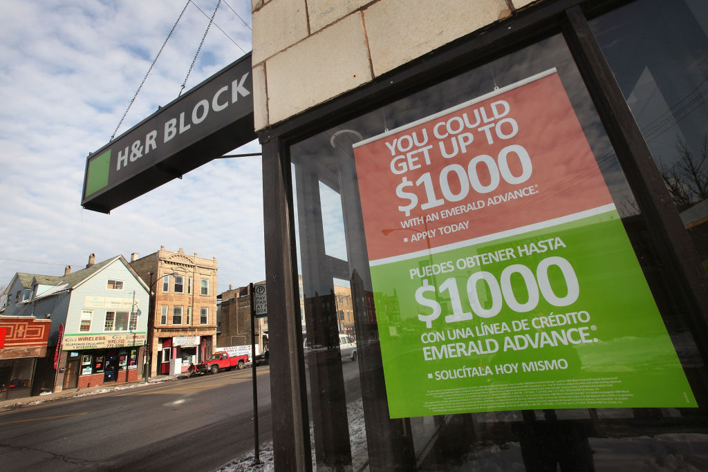 A sign marks the location of an H&R Block office on December 28, 2010 in Chicago, Illinois. The banking partner of  H&R Block Inc. has been ordered to stop making refund anticipation loans used by millions of Block's customers. Some analysts believe the move could cost the tax preparer as much as seven percent of its business this tax season.