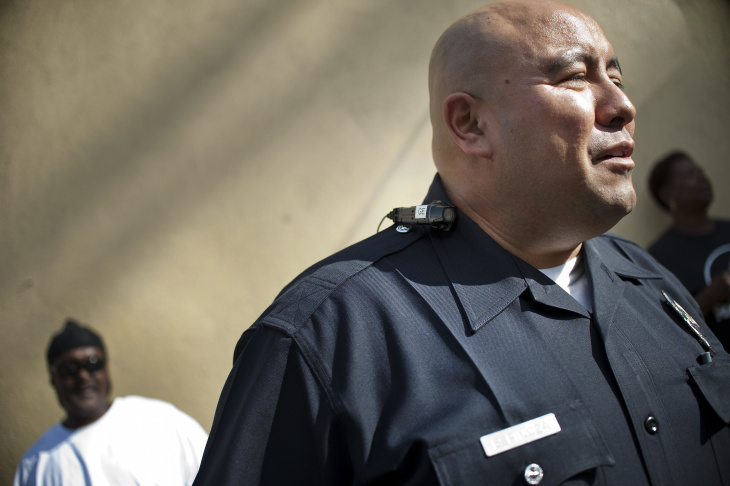 LAPD Officer Guillermo Espinoza wears a video camera on his lapel. Espinoza is one of 30 officers in the downtown area that began testing body cameras this month.