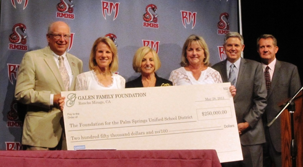 Helene Galen, third from left, presented a $250,000 check to the Palm Springs Unified District. It's the first in a six-year installment on a $1.5 million pledge.