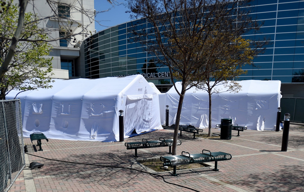Tents setup outside the main entrance to Harbor-UCLA Medical Center in Torrance, Calif., Wednesday, April 1, 2020. The hospital plans to triple the number of available ICU beds to care for patients amidst the spread of COVID-19.