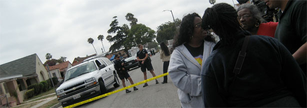 Police and local residents gather near the house of Lonnie Franklin Jr., 57, in South Los Angeles.