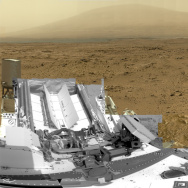 A photo released by NASA this summer shows a photo composed of nearly 900 images taken by the rover Curiosity, showing a section of Gale Crater near the equator of Mars. The rovers are continuing to work through the U.S. government shutdown.