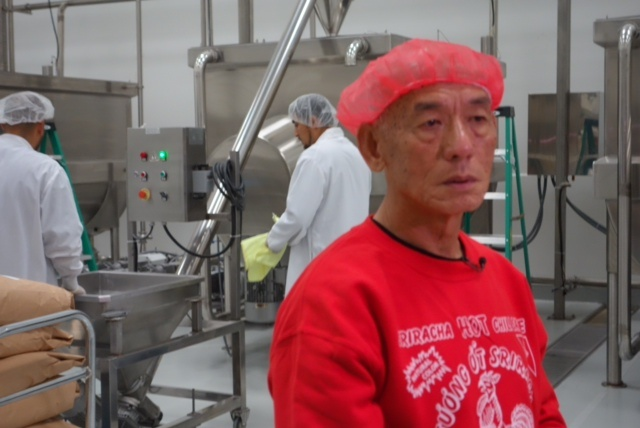 Huy Fong Foods Inc. owner David Tran with machines that mix Sriracha chili sauce ingredients, including crushed jalapeño chilis from Ventura County, sugar, spices and garlic.