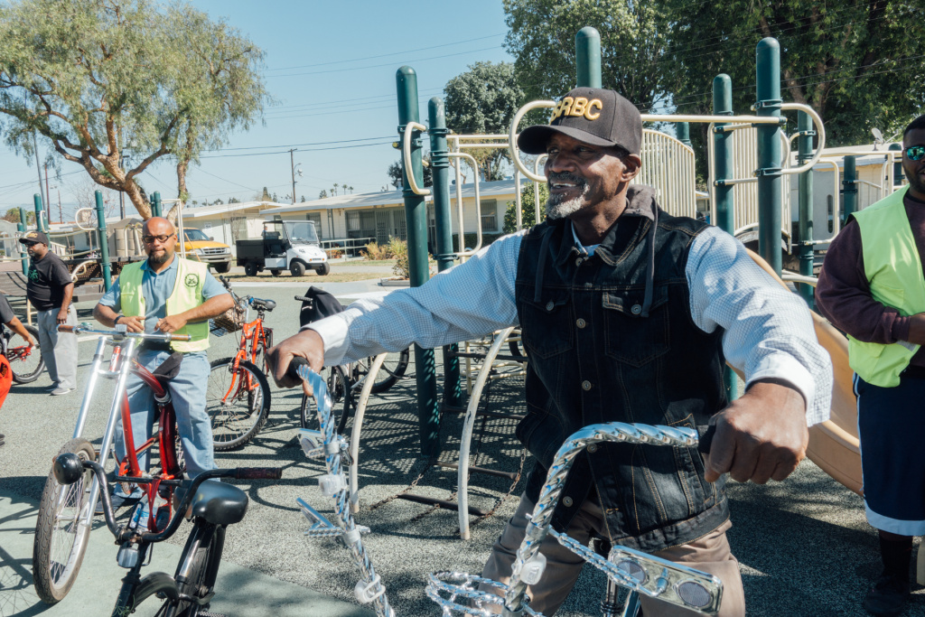 Army veteran Dale Williams with the East Side Riders Bike Club showed his support for The Mission Continues playground beautification project at Gonzaque Village in Watts.