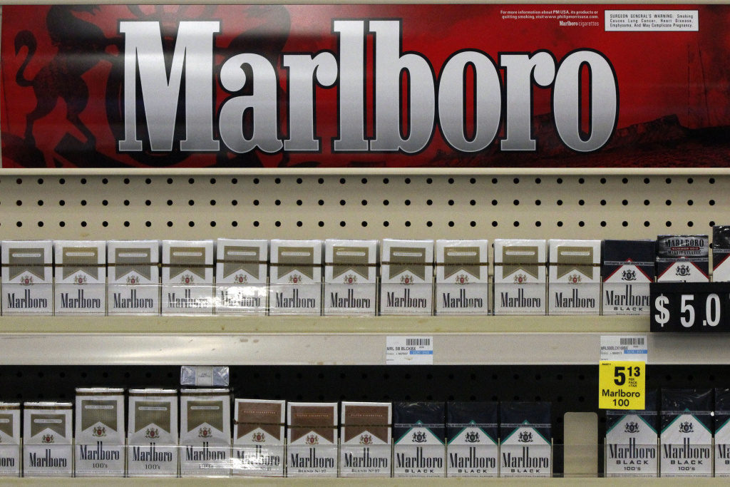 In this Wednesday, July 17, 2013 file photo, Marlboro cigarettes are on display in a CVS store in Pittsburgh. The nation's second-largest drugstore chain says it will phase out cigarettes, cigars and chewing tobacco by Oct. 1 as it continues to focus more on health care.