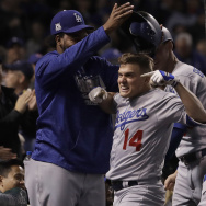 Los Angeles Dodgers' Enrique Hernandez his grand slam in Game 5 of the National League Championship Series against the Chicago Cubs on Thursday in Chicago.