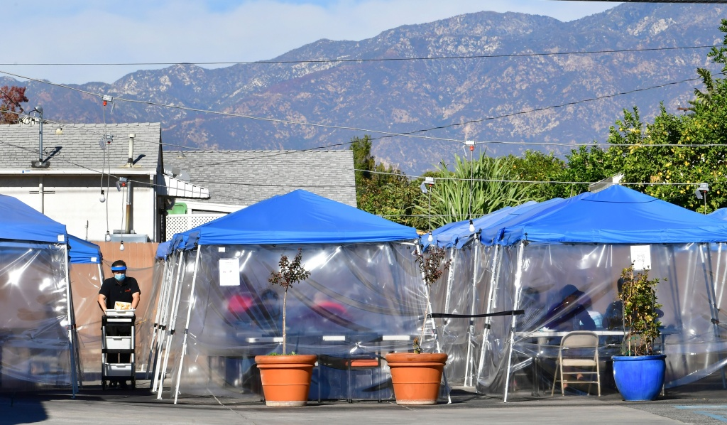 Tents for outdoor dining are seen in a restaurant's parking lot on November 17, 2020 in Alhambra, California, amid the coronavirus pandemic.