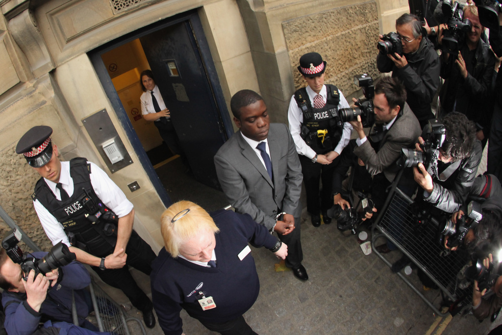 Kweku Adoboli (C), a trader for the Swiss investment bank UBS leaves the City of London Magistrates Court on September 22, 2011 in London, England.