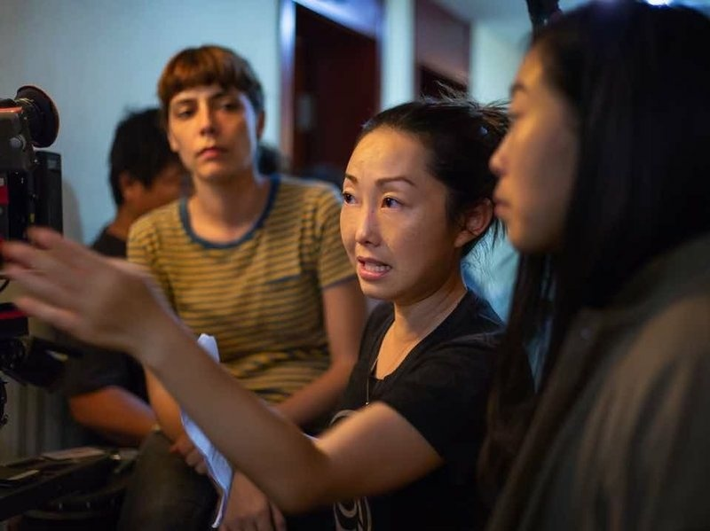 Lulu Wang, center, directing a scene from