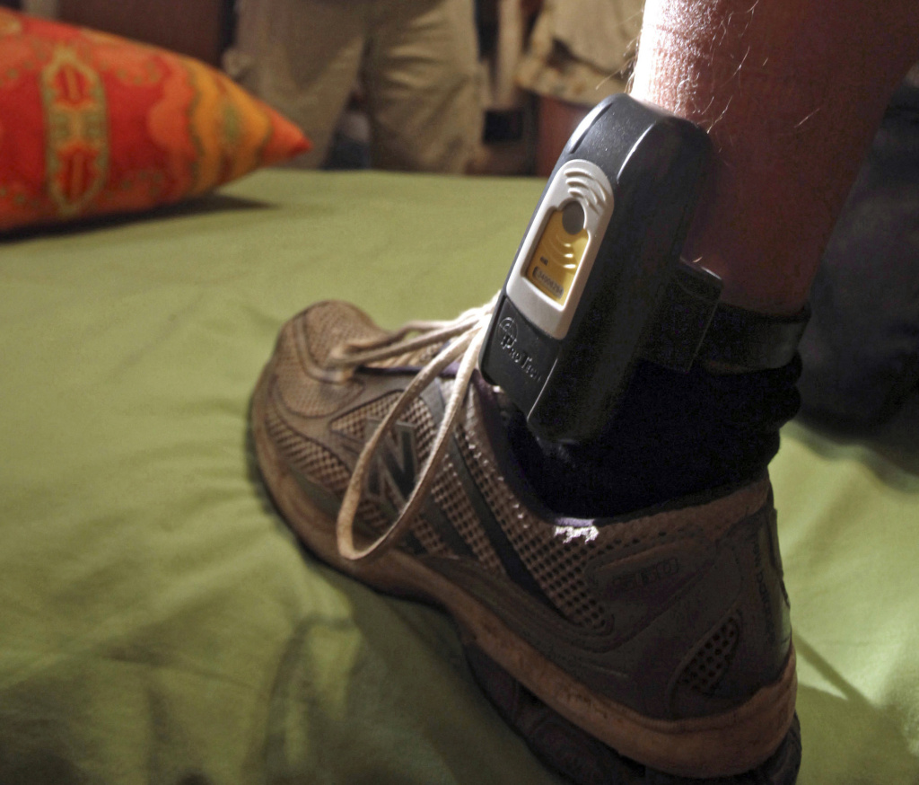 This Aug. 3, 2009, file photo shows a GPS locater worn on the ankle of a parolee in Rio Linda, Calif. Legal scholars say stringent rules in California for juvenile offenders who are required to wear GPS monitoring bracelets are cycling children back behind bars for minor infractions. A report being released Wednesday, July 12, 2017, by the University of California, Berkeley, and the East Bay Law Center found