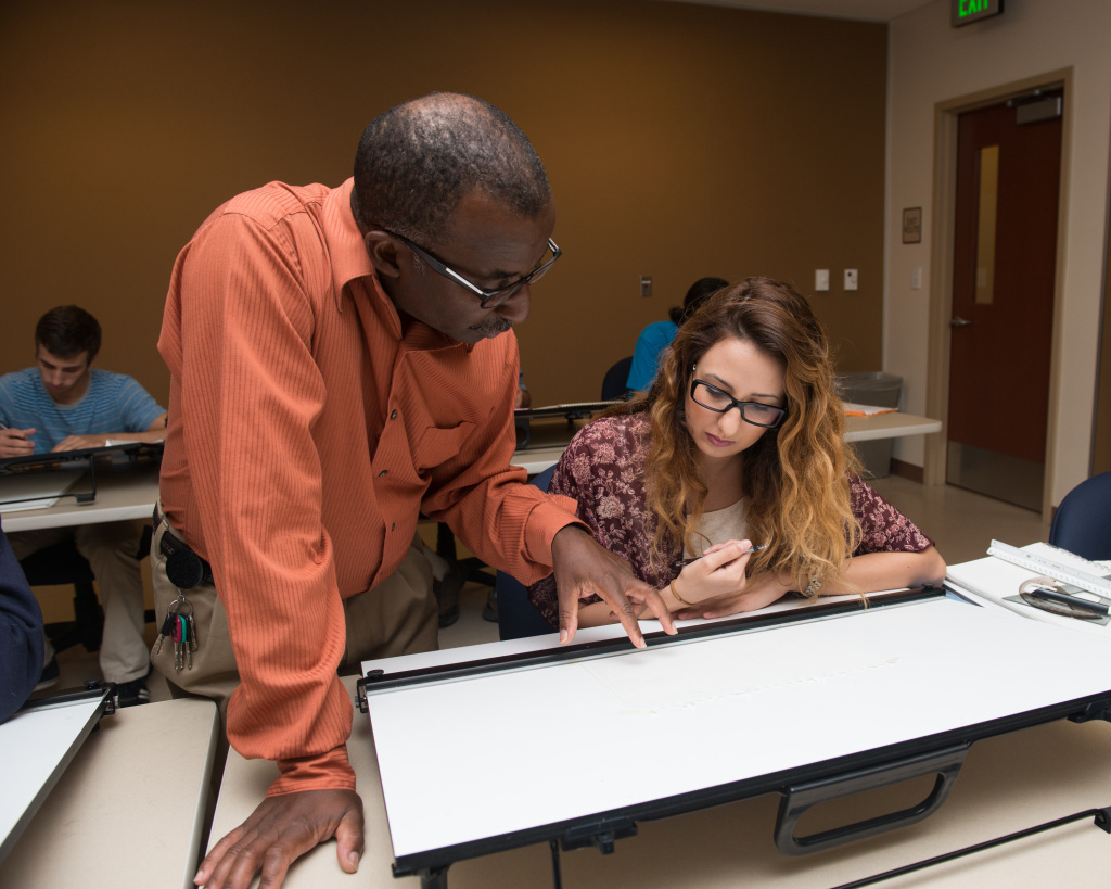 FILE: Professor David Thomas Helps A Student In A Fullerton College Architecture  Class.