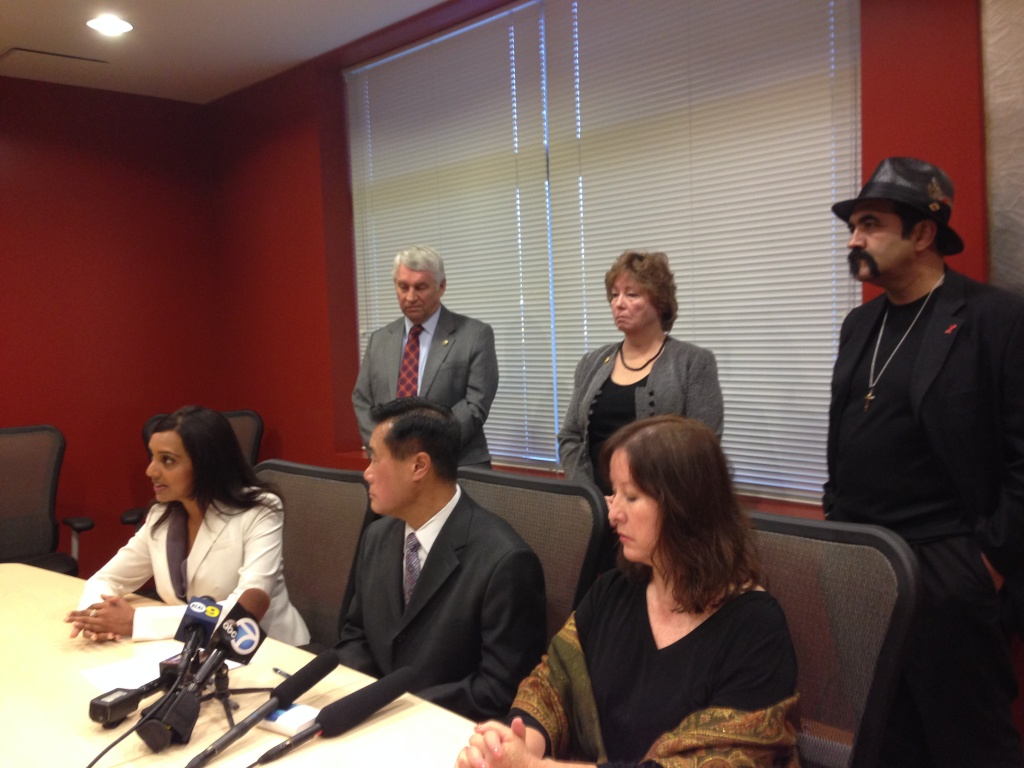Supporters of a Riverside boy convicted of murdering his abusive father call for his pardon on November 5, 2013. In the front row, from left to right are: Defense attorney Punam Grewal; CA Senator Leland Yee; and Former CA Senator Gloria Romero; In the back row, from left to right are: Kenneth Bitting, Tania Whiteleather and Steve Figueroa who are advocates of the child.
