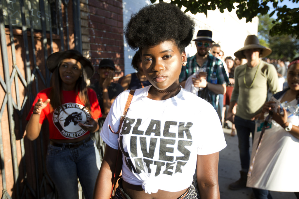 Tiah Barnes a USC student waits in line outside the Black Lives Matter LA performance art show at The Underground Museum Washington Boulevard in Los Angeles on July 8th, 2016.