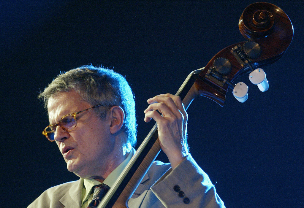 In this file photo, U.S. Iowa-born jazz musician Charlie Haden performs late 14 July 2005 at the Vitoria-Gasteiz Jazz Festival in the Spanish northern Basque city of Vitoria. Haden's label, ECM, reported Friday that he had died at 77.