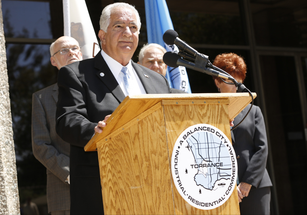 Torrance Mayor Frank Scotto, at podium, holds a news conference to discuss the announced relocation of Toyota Motor Sales' U.S. headquarters, Monday, April 28, 2014, in front of City Hall in Torrance, Calif.  Toyota said that it will move its U.S. headquarters from Torrance to Plano, Texas, a suburb of Dallas. Small groups of employees will start moving to temporary office space there this year, but most will not move until late 2016 or early 2017 when a new headquarters is completed.