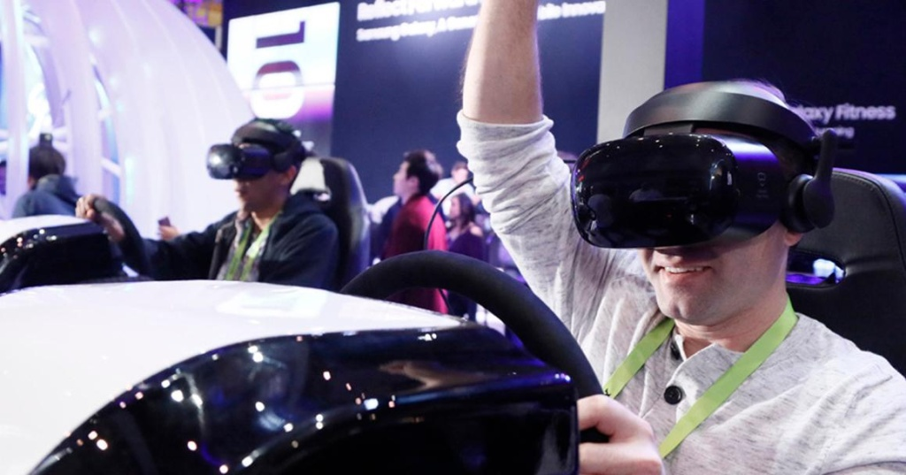 Participants try out new technology at the CES 2020 conference.