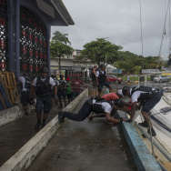 Police officers moor a boat that washed ashore on the Quai de la Darse in Pointe-a-Pitre, on the French overseas island of Guadeloupe, after high winds from Hurricane Irma hit the island.