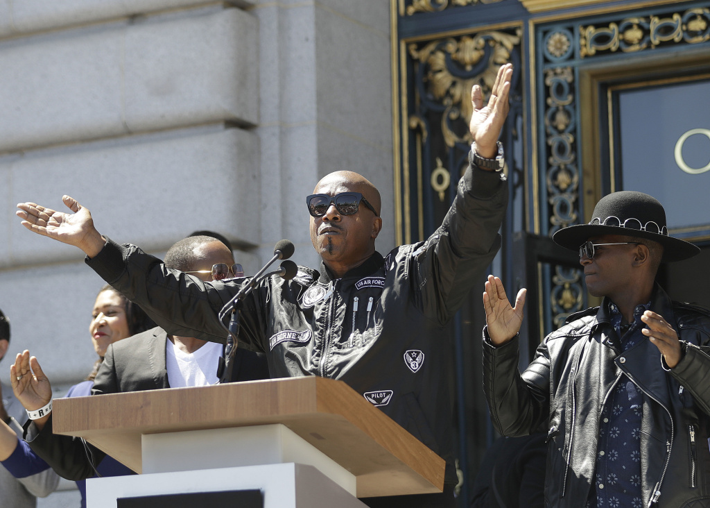 Musician MC Hammer speaks at a rally in San Francisco, Friday, Aug. 25, 2017, ahead of politically conservative rallies scheduled this weekend. Concerned about possible violence, city officials have urged residents to stay away from other gatherings on Saturday and Sunday.