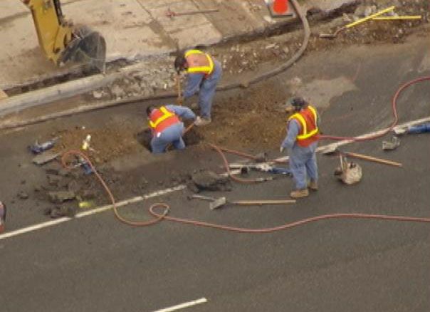 Workers repair a gas line leak in Malibu, Thursday, Nov. 8, 2012.