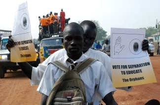 Southern Sudanese rally on the streets of the southern capital Juba on December 9, 2010, marking the one month countdown until a landmark independence referendum is due, which could see Sudan's autonomous and mostly Christian south break away from the predominantly Arab and Muslim north.