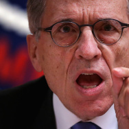 Federal Communications Commission (FCC) Chairman Tom Wheeler listens during an open meeting to receive public comment on proposed open Internet notice of proposed rulemaking and spectrum auctions May 15, 2014 at the FCC headquarters in Washington, DC.