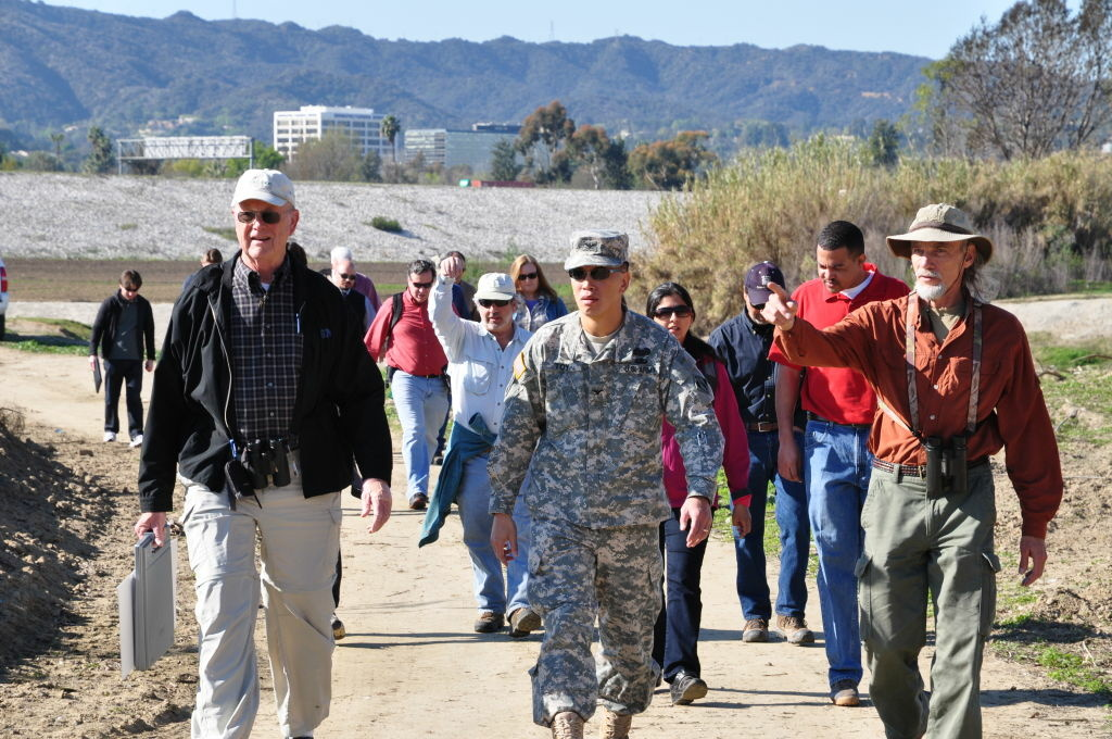 San Fernando Valley Audubon Society President Dave Weeshof, Los Angeles District Commander Col. Mark Toy and SFVAS Conservation Chair Kris Ohlenkamp lead a group of Corps employees and local environmentalists on a nature walk Feb. 12 at the Sepulveda Dam Basin vegetation management area.