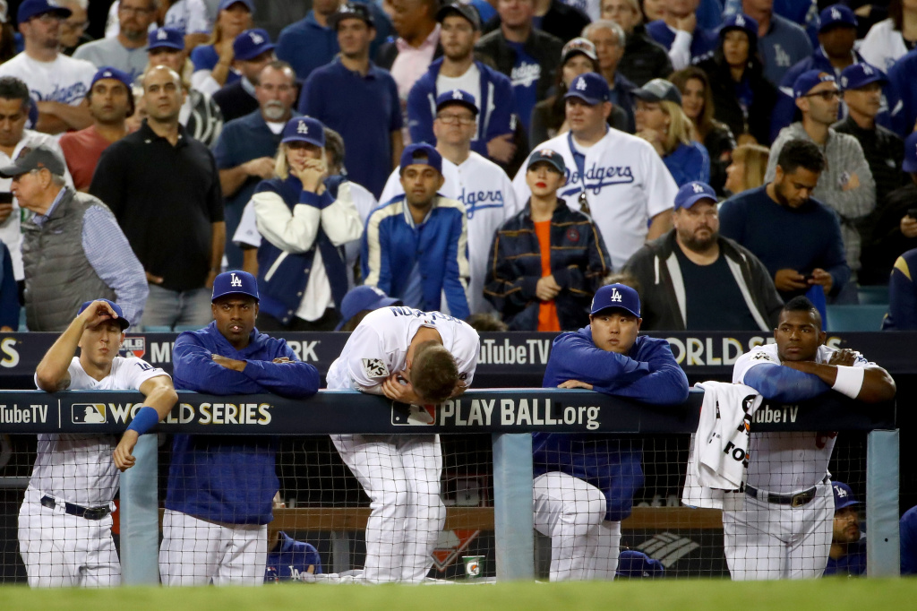The Los Angeles Dodgers watch the ninth inning from the top step against the Houston Astros in game seven of the 2017 World Series at Dodger Stadium on Nov. 1, 2017.