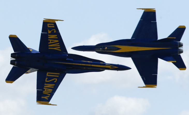 In this Friday, Oct. 12, 2012 file photo, two U.S. Navy Blue Angels execute a crossing maneuver at close range during the Miramar Air Show in San Diego. Marine Corps officials have said the show would be canceled this year because of the federal government shutdown.