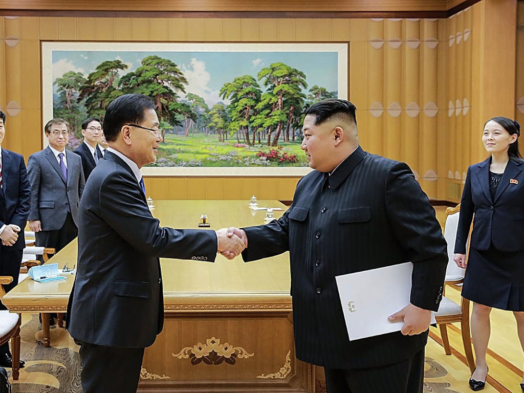 In this handout image provided by the South Korean Presidential Blue House, Chung Eui-Yong (left), head of the presidential National Security Office shakes hands with North Korean leader Kim Jong-Un during their meeting on Monday in Pyongyang.