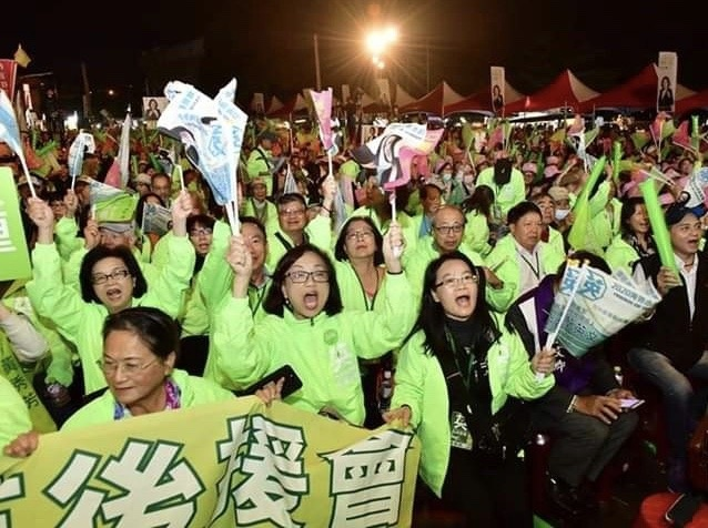 Southern Californian Taiwanese, including those pictured in green jackets, have returned to the island to vote in the contest for president.