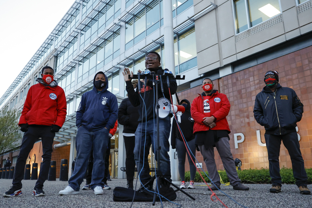 Chicago activist Ja'Mal Green (C) speaks outside the Chicago Police headquarters during a rally on April 15, 2021 in Chicago, Illinois.
