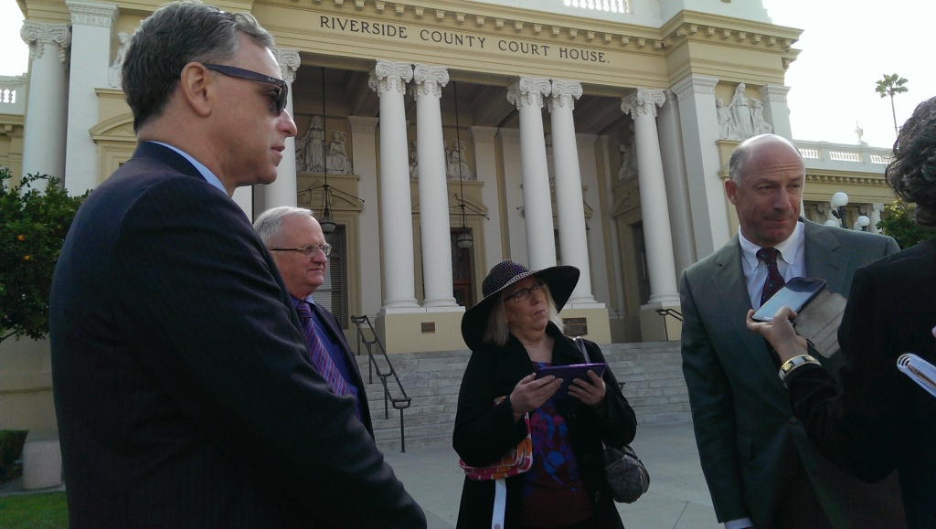 Roy Goldberg (left) and Andrew Cronthall speak with reporters outside the Riverside County courthouse after a status update on the Ontario Airport on Wednesday, February 5, 2014.