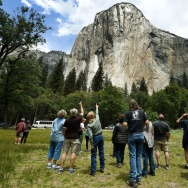 Visitors look up at the El Capitan monolith in the Yosemite National Park in California.