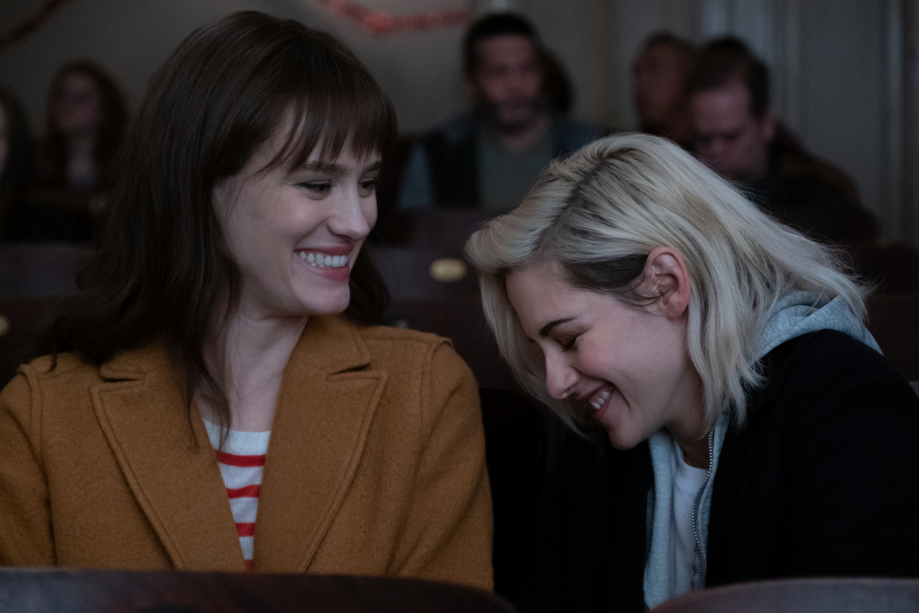 Abby (Kristen Stewart) and Harper (Mackenzie Davis) enjoy a moment at the movies in TriStar Pictures' romantic comedy
