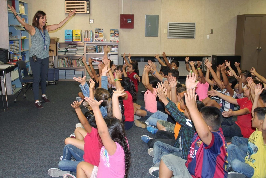 General music teacher Rosanne Forgette leads third graders at Rowland Elementary School in song.