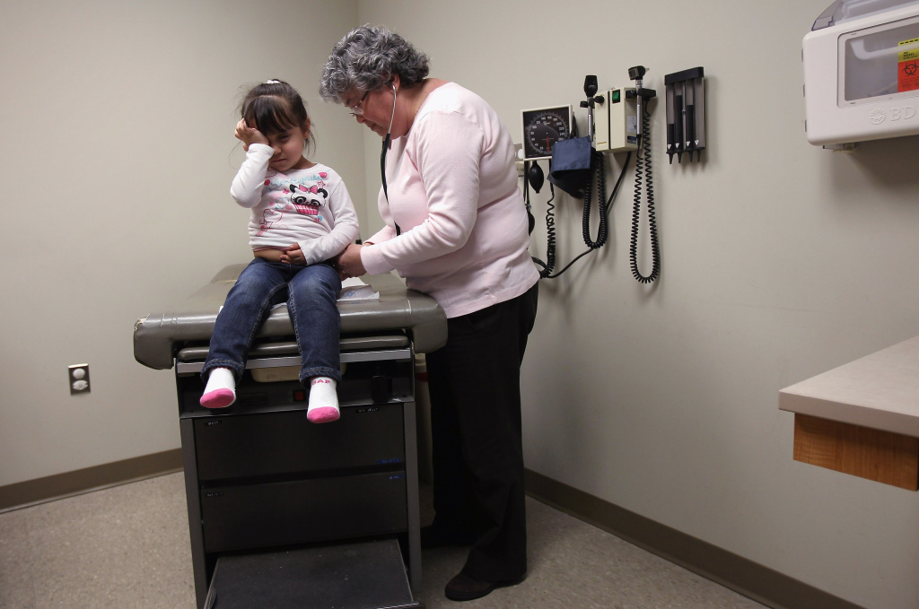 Physician's assistant Ann Valdez checks out Amy Morales, 2, during a check-up at a community health center on March 27, 2012 in Aurora, Colorado. The center, called the Metro Community Provider Network, has received some 6,000 more Medicaid eligable patients since the healthcare reform law was passed in 2010.