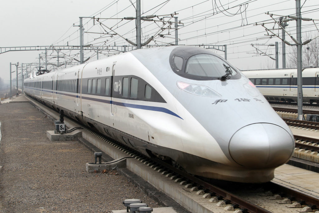 The high speed train that runs on the new 2,298-kilometre (1,425-mile) line between Beijing and Guangzhou runs into Xuchang East Station in Xuchang, central China's Henan province on December 26, 2012.