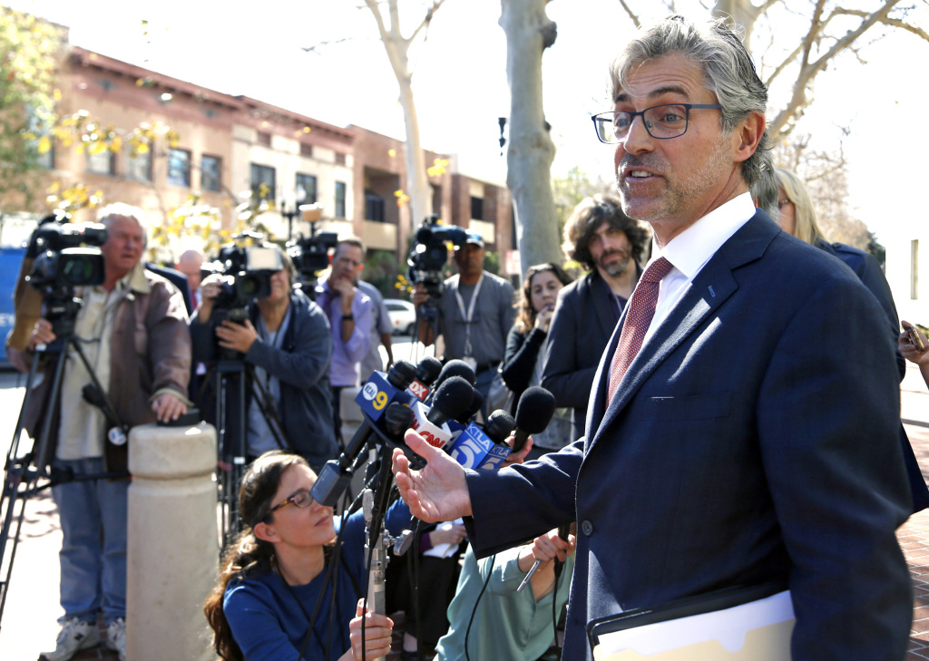 Attorney Robert Blume speaks to reporters outside federal court in Santa Ana, California, after an Afghan family of five who had traveled to the United States on special visas were detained on arrival, but were ordered released from custody on March 6, 2017. The mother, father and their three young sons, including a baby, arrived at Los Angeles International Airport on Thursday.
